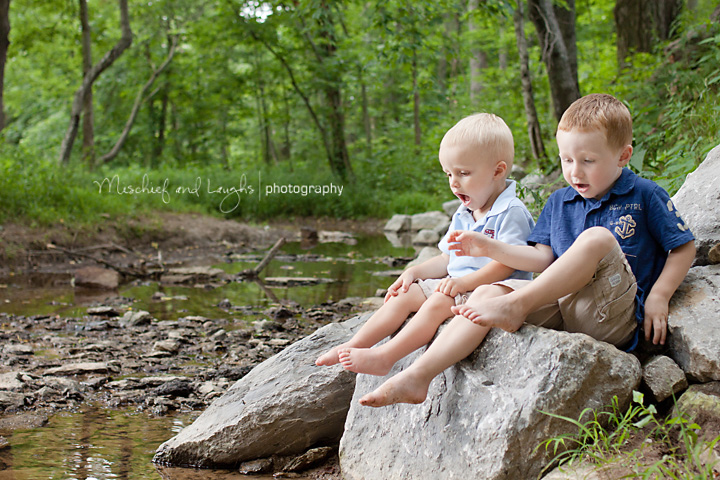 children surprised as they look into the creek