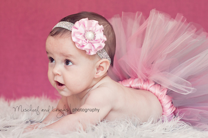Cincinnati based child photographer takes picture of baby in a tutu