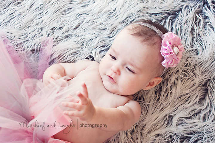 4-month-old is captivated by the tutu her mother put on her for pictures.