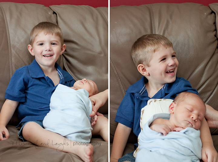 big brother holds his new baby