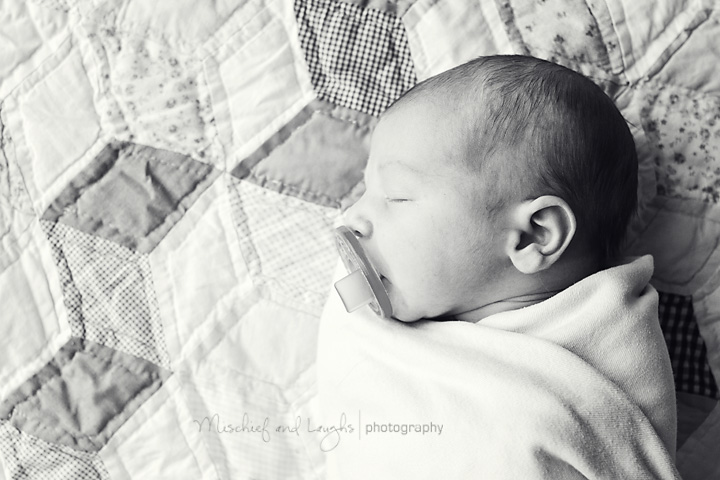 Newborn photographer takes sleeping baby's picture