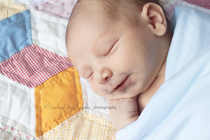 newborn baby gives cincinnati photographer a smile