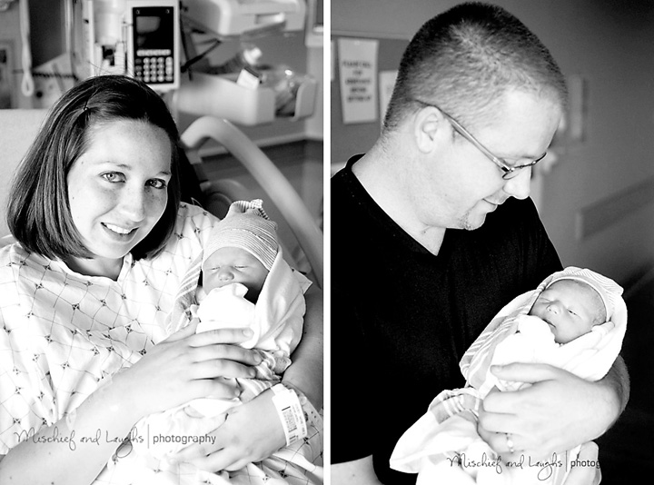 Mom and dad hold their newborn son