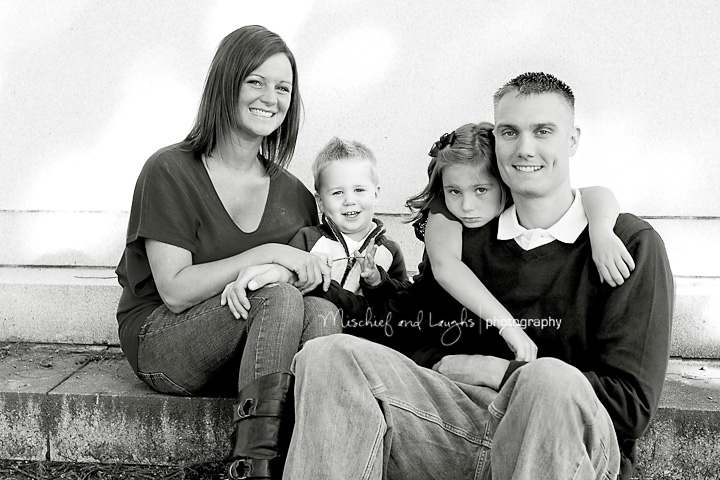 Family takes a beautiful black and white portrait