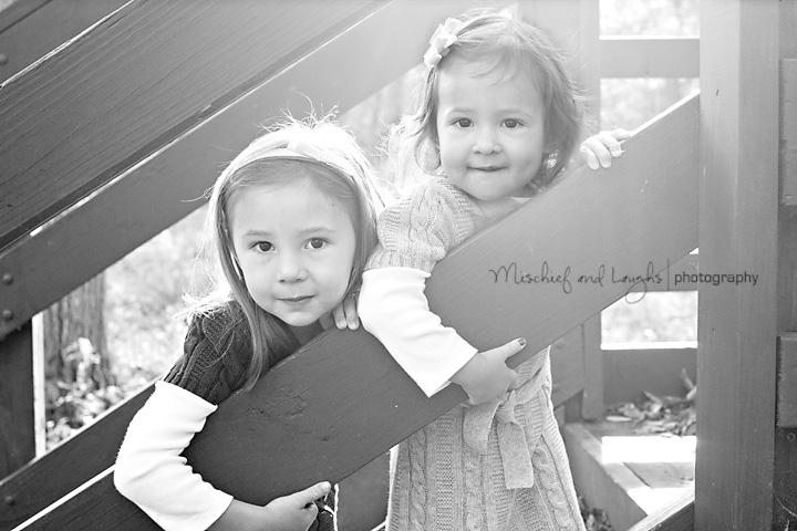 sun lit portrait of two little girls