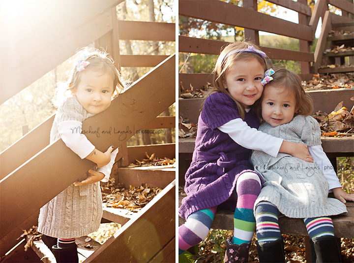 sisters hugging on a wooden bridge