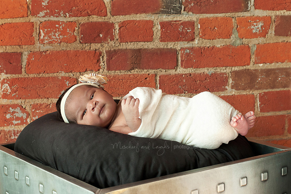 little baby is wrapped up tightly for her portraits