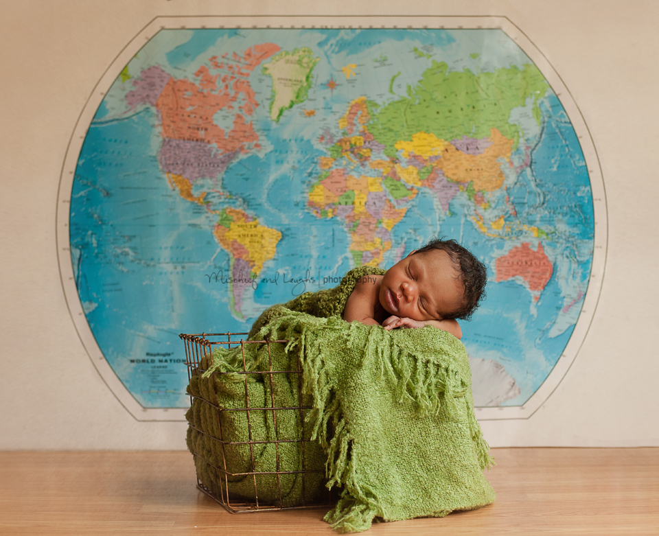 newborn baby photo ideas, baby boy with a map