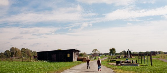 The farm offers wide open fields, silos, and barns.