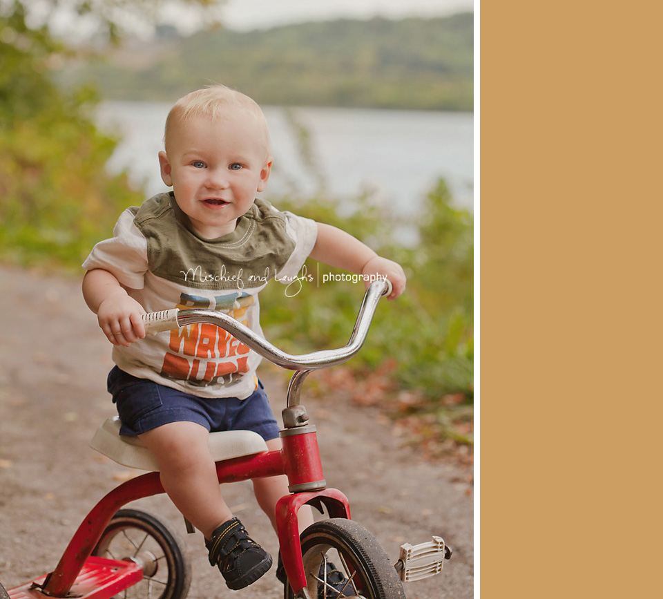 toddler sitting on a tricycle