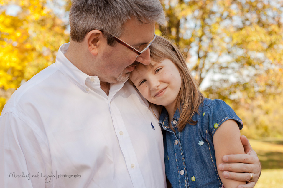 father daughter pictures with young child leaning on dad