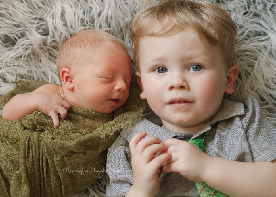 brand new baby with his proud big brother