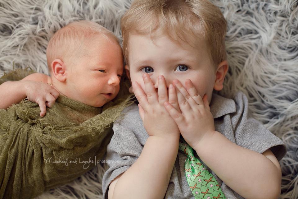 Newborn baby and toddler boy
