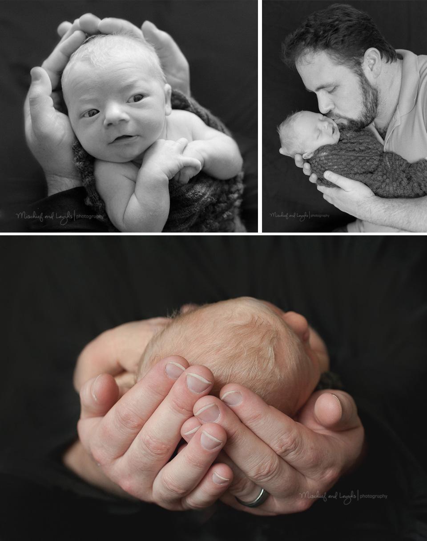baby in dad's hands