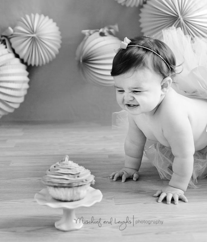 baby with cake first birthday