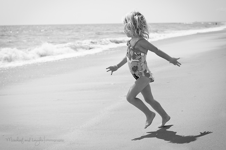 Little Girl running to the water
