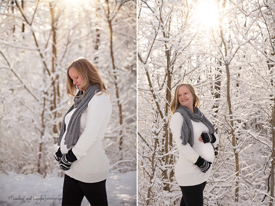 pregnant momma poses for pictures in snow