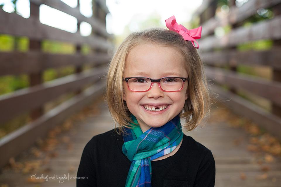 Children's portrait on a bridge, Mischief and Laughs Photography