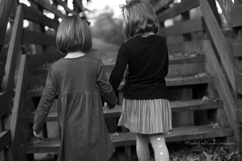 Sisters Holding Hands, Mischief and Laughs Photography