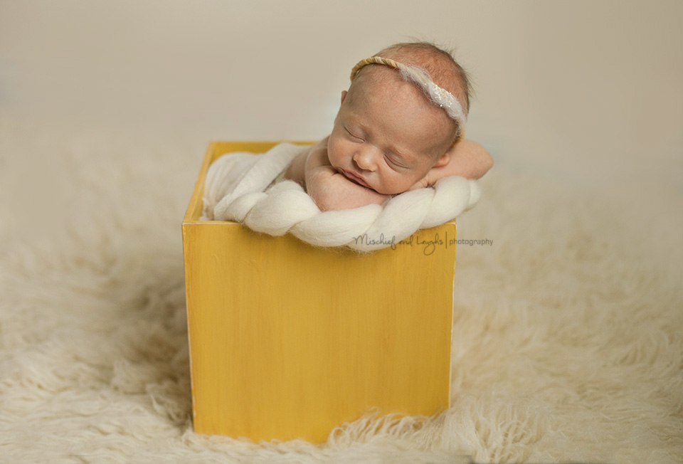 Newborn baby with angel halo, Cincinnati newborn photos, Mischief and Laughs