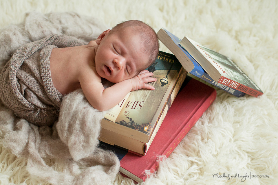 Newborn with books mischief and laughs northern kentucky newborn photography
