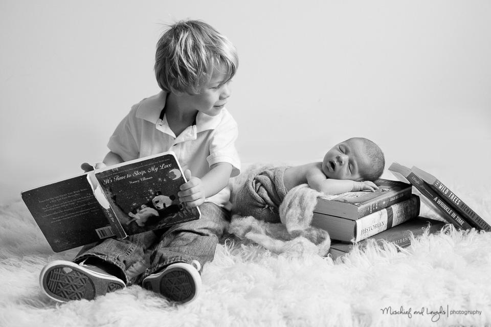 newborn with books, Mischief and Laughs, Northern Kentucky newborn photography