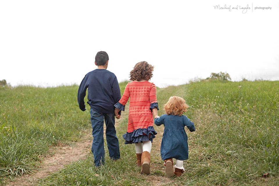 three kids on the farm