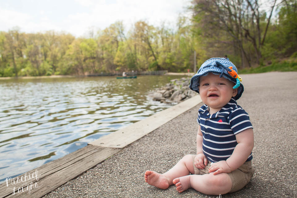 Baby on boat dock, Canandaigua NY Photographer, Mischief and Laughs