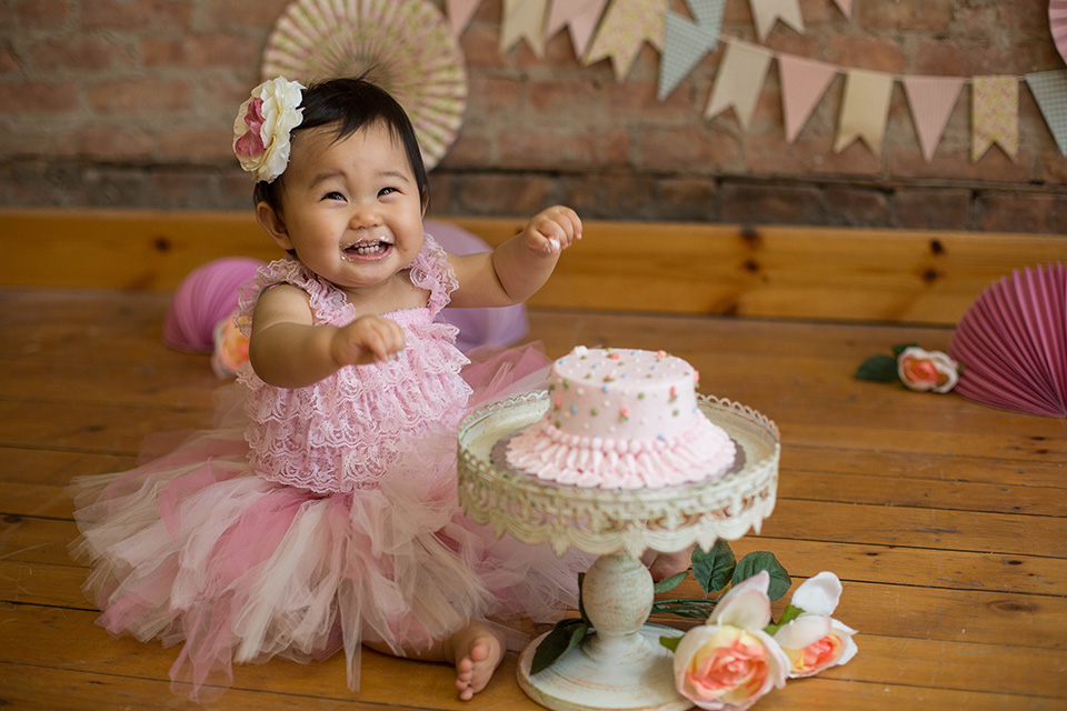 Light pink pastel girl cake smash session, Rochester NY Cake Smash, Mischief and Laughs Photography