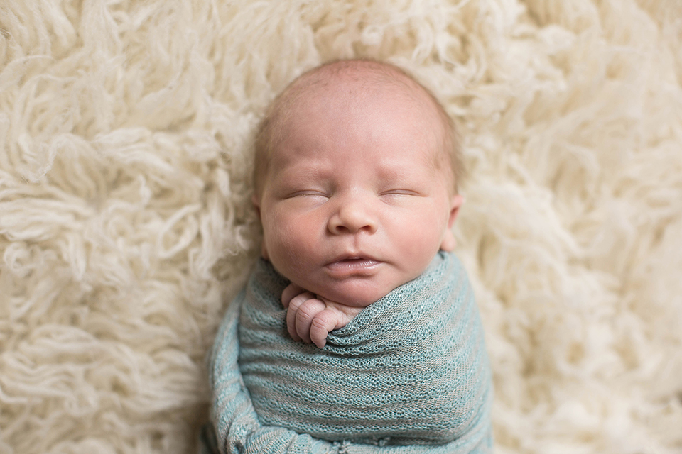newborn baby swaddled pose, Rochester NY newborn photos, Mischief and Laughs Photography