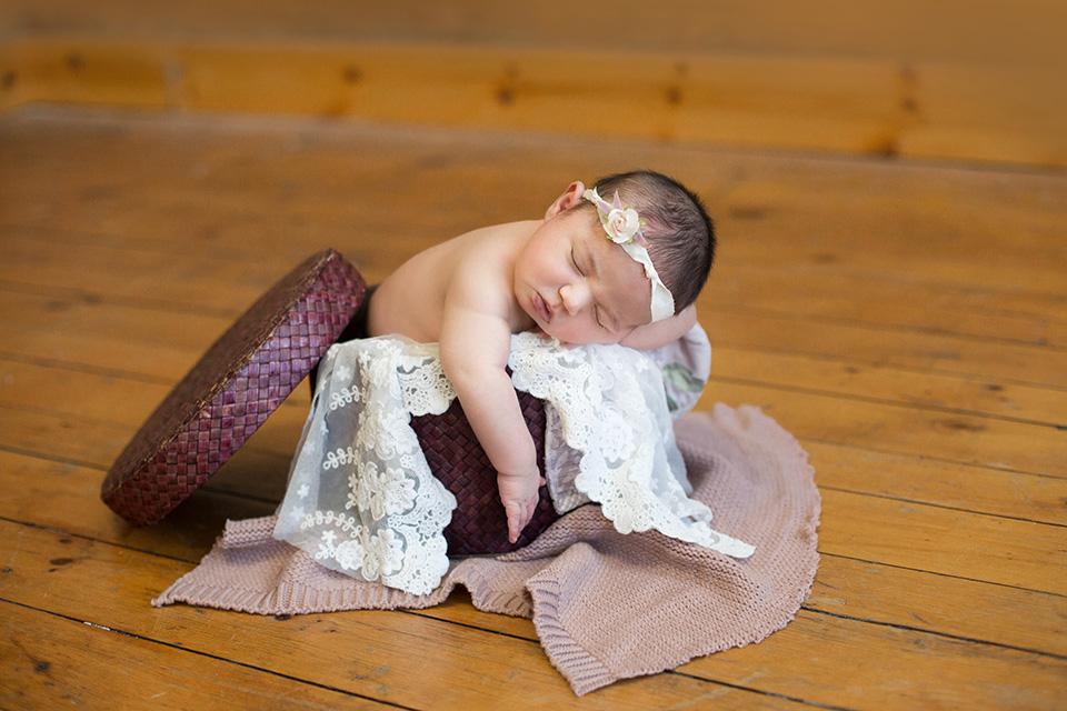 newborn baby on vintage hat box prop photos, Rochester Newborn Photographer, Mischief and Laughs Photography