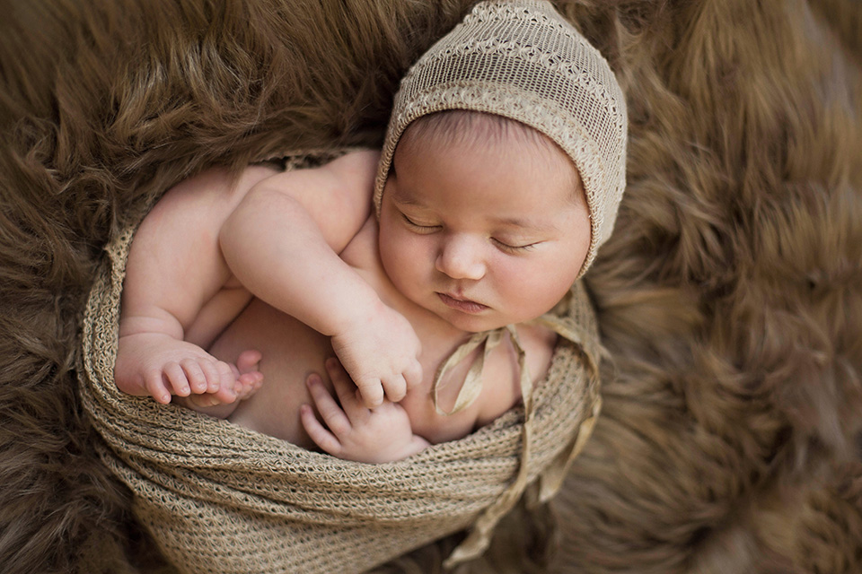 Newborn baby fur rochester newborn photographer mischief and laughs photography