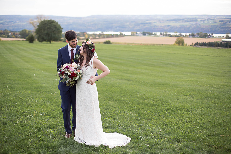 Happy couple overlooking the Seneca Lake, Logan Ridge Estates Wedding, Finger Lakes Photographer