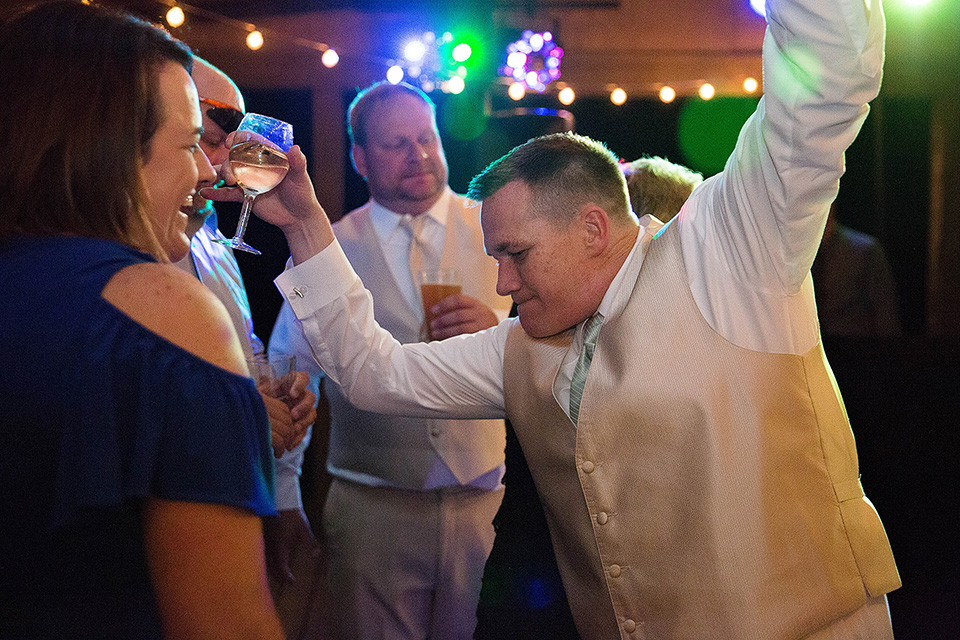 Reception Photos groom dancing and kissing, Finger Lakes wedding photographer, Zugibe Vineyards
