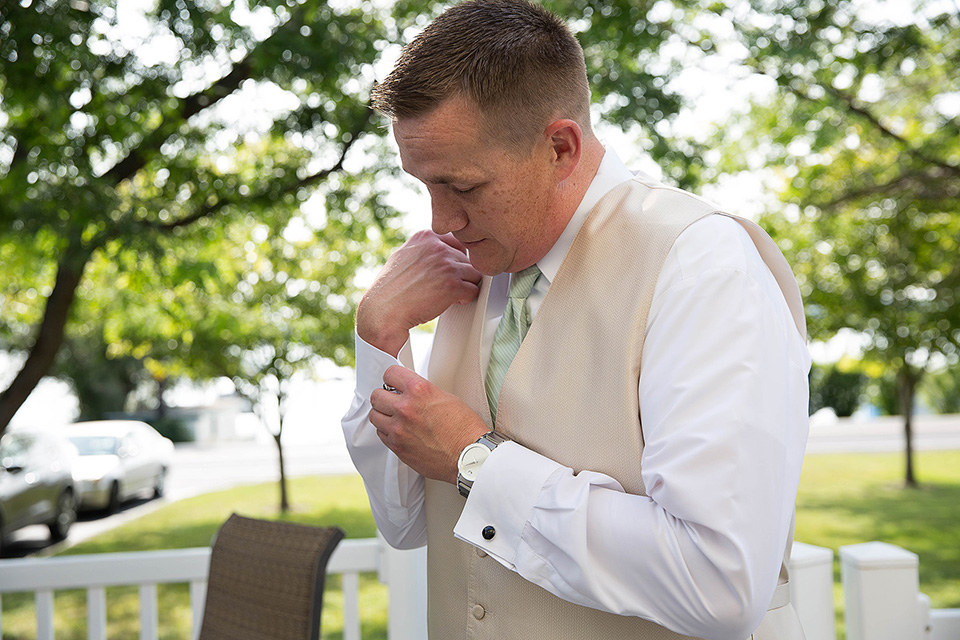 Groom gets ready at the lake house, Finger Lakes wedding photographer