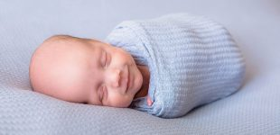 Newborn smiling Swaddle Pictures, Newborn photographer in Canandaigua NY