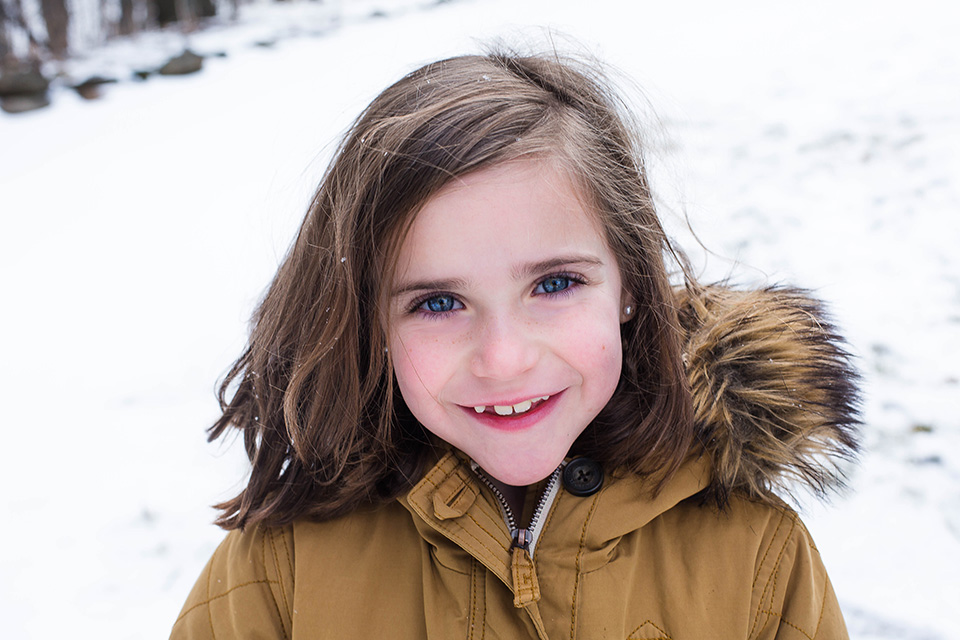 professional family photographer in Cincinnati OH, snow portrait session