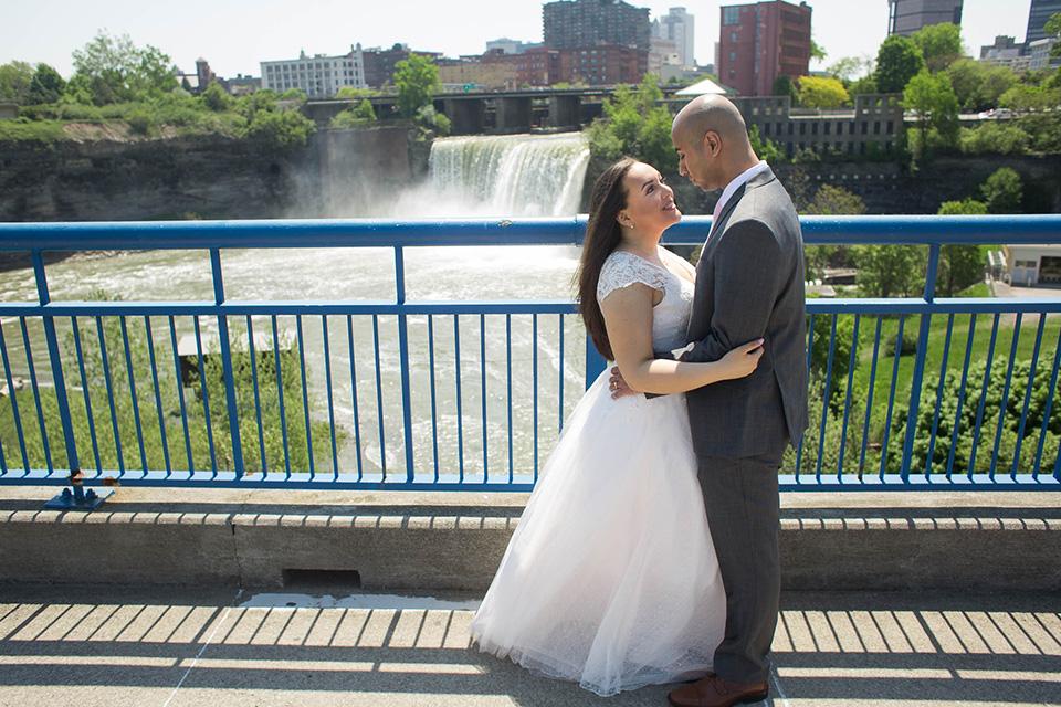 outdoor portraits on a bridge over river