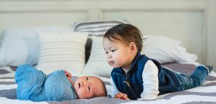 Newborn with his big brother, in home newborn photography Cincinnati OH