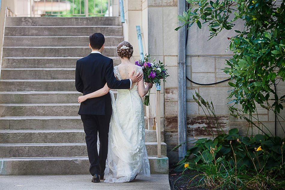 Bride and groom walk together to reception