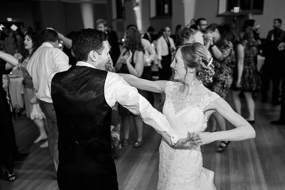 candid dance photos at wedding reception in Cincinnati