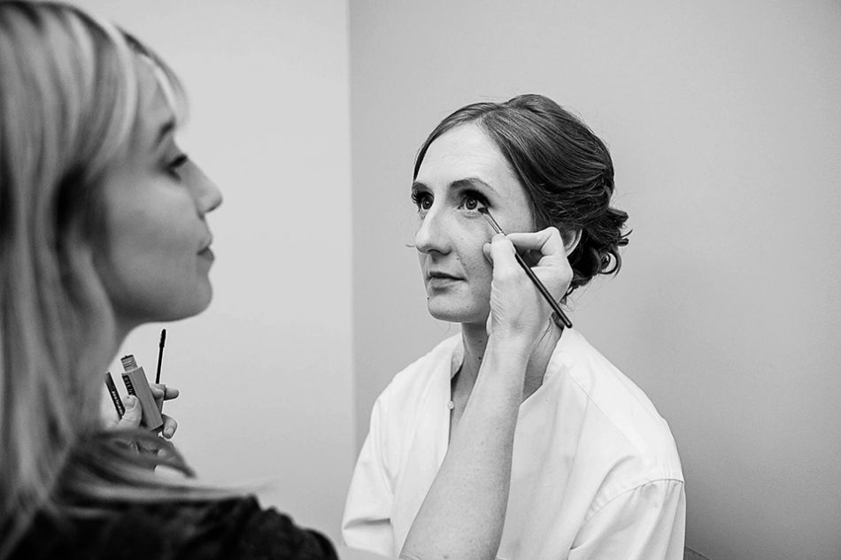 Makeup artist applies a bride's makeup