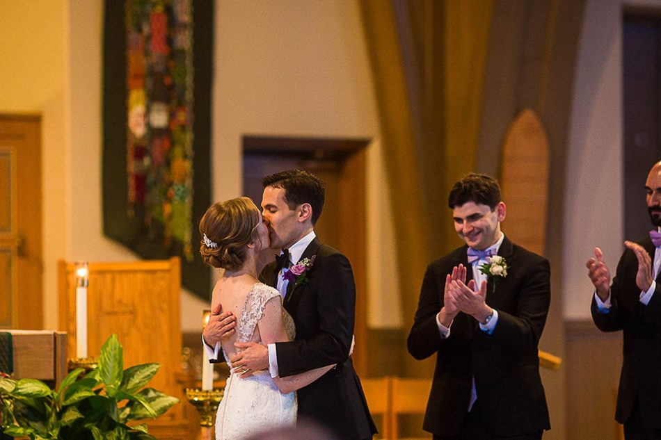 bride and groom's first kiss as husband and wife, St Clare church Cincinnati OH