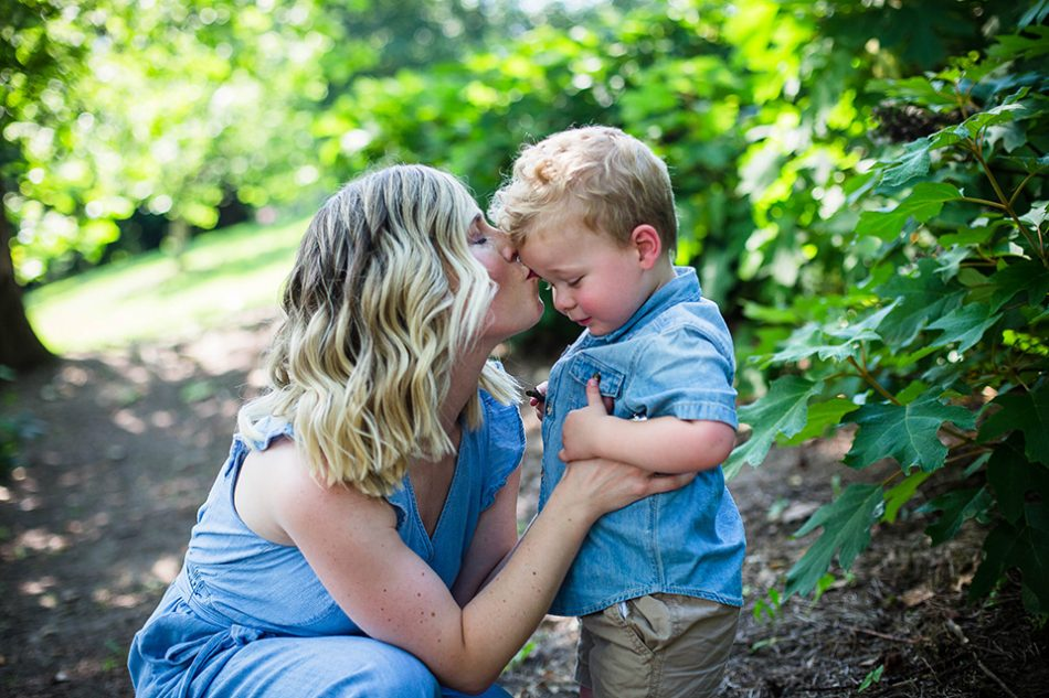 mom kissing little boy on forehead, Cincinnati OH children's photographer