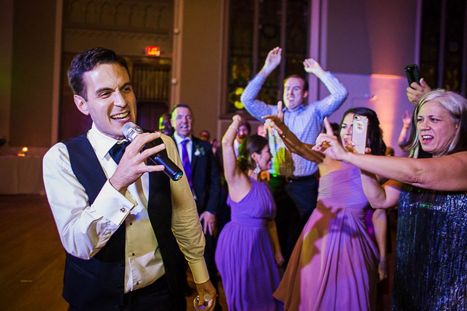 Groom rapping during his wedding reception