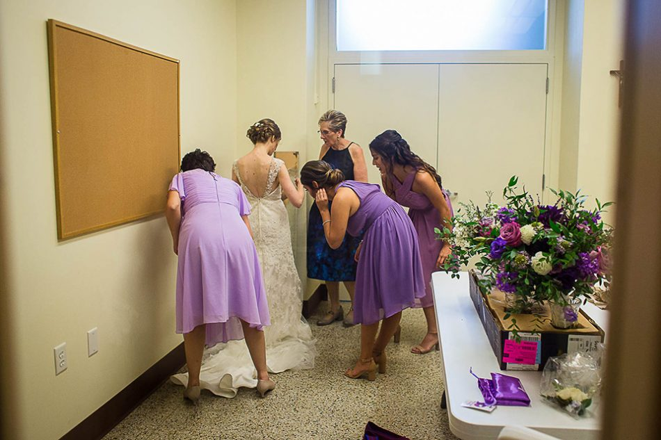 bride getting dressed before her wedding